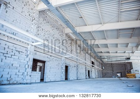Building. Construction of a new warehouse with new walls made of  brick