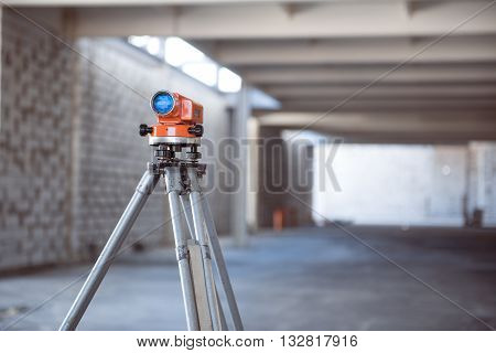 Leveling. A theodolite-level standing in a new building may be used in construction works