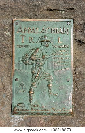 Dahlonega, GA: May 2, 2015: A copper plaque marks the beginning of the Appalachian Trail on Springer Mountain
