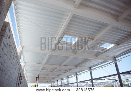 Metallic ceiling. Construction works of new industrial building, as a background
