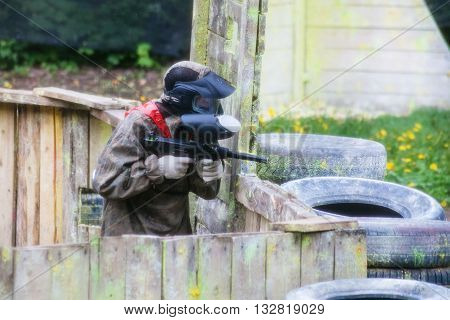Player In Camouflage During Playing Paintball