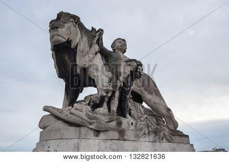 Statue of Pont Alexandre III bridge over the river Seine in the dusk Paris France