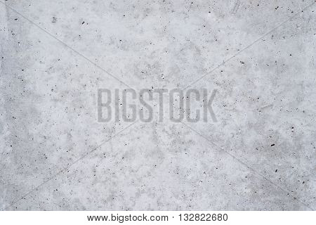As a background.  A concrete wall with some spots and very small holes, picture may be used as a background