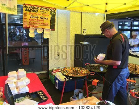 AUCKLANDJUNE 4: Cook prepare paella is a Valencian rice dish at the La Cigale French Market in Auckland New Zealand on June 4 2016.