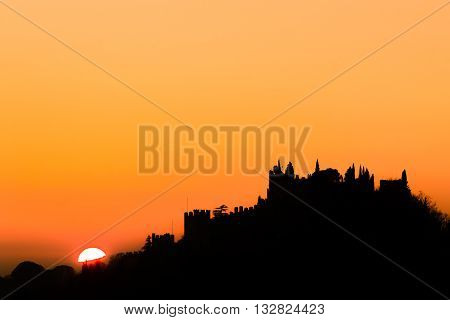 Castle silhouette at sundown. Italian panorama from