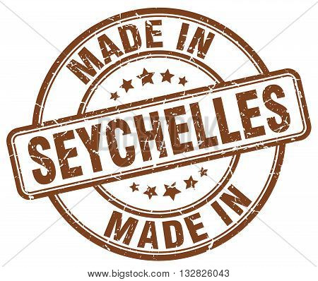 made in Seychelles brown round vintage stamp.Seychelles stamp.Seychelles seal.Seychelles tag.Seychelles.Seychelles sign.Seychelles.Seychelles label.stamp.made.in.made in.