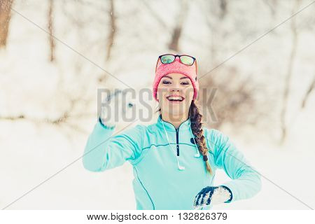 Girl Has Fun Throwing Snowballs
