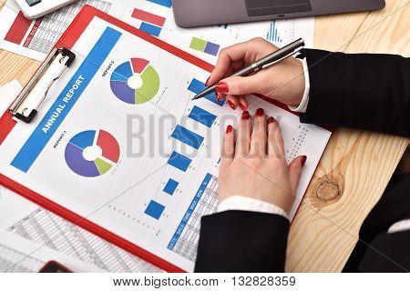 Businesswoman Checks Report