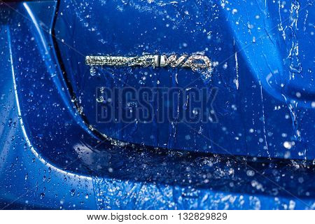 BANGKOK, THAILAND - JUNE 2, 2016 : Water dripping down on symmetrical AWD emblem of all-new Subaru WRX