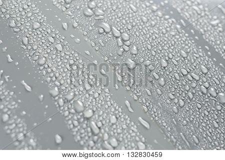 Car detailing series : Droplets on grey car bonnet