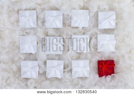 Still Life Concept Of One Red And Many White Gifts