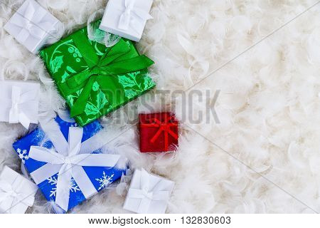 Various Gift Boxes With Copy Space In Feathers