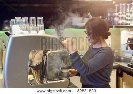 Female Barista Or Waitress Making Cappuccino