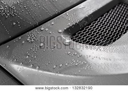 Car detailing series : Droplets on grey car trunk