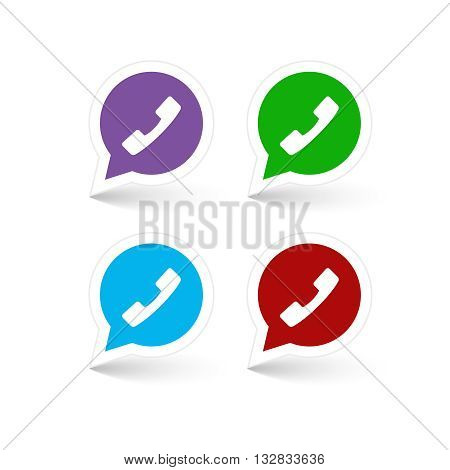 Set of green, red, blue and lilac phone handset in speech bubble icon.
