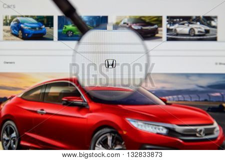 MONTREAL CANADA - JUNE 4 2016 : Photo of Honda web page on a laptop screen through a magnifying glass.