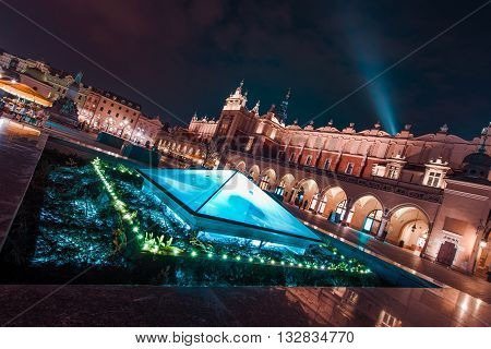 Magnificent Krakow at Night. Cracow Market Square During Late Night Hours Poland Europe. Medieval and Modern Architecture Combined.