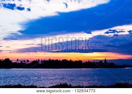Sunset at temple riverside chao phraya river Pathumthani Thailand