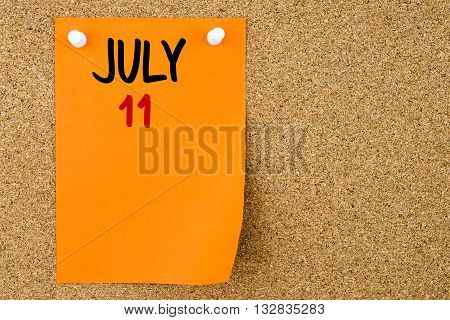 11 July Written On Orange Paper Note
