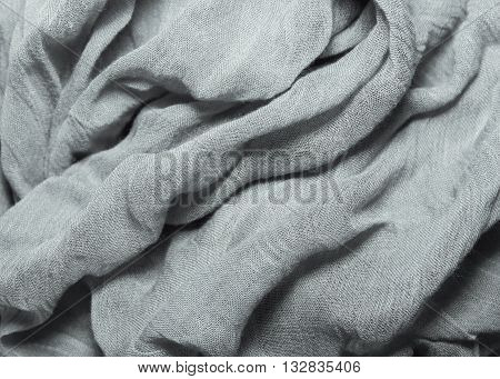 fabric texture cotton and silk crumpled fabric folds lying on a table background