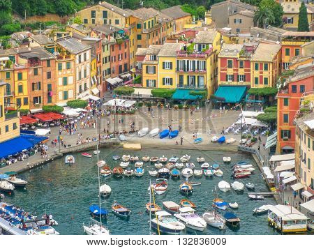 Portofino, Liguria, Italy - circa June 2010: aerial view of Portofino, a famous vacation resort with a picturesque harbor, luxury yachts and celebrity. Italian fishing village.