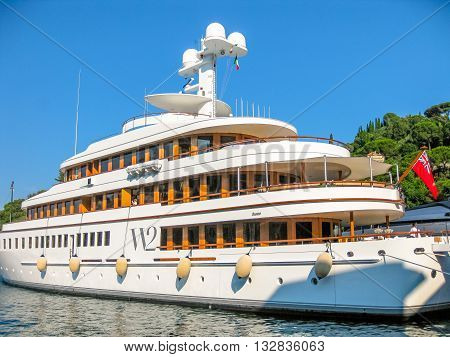 Portofino, Liguria, Italy - circa June 2010: a large luxury yachts in the harbor of Portofino, famous Italian tourist resort for celebrities and wealthy people.