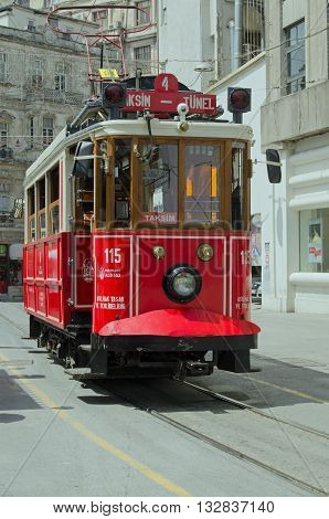 ISTANBUL TURKEY - JUNE 3 2016: View of one of the tram cars operating on the Nostalgia Tram route across the fashionable Beyoğlu district of Istanbul Turkey.