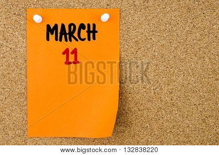 11 March Written On Orange Paper Note