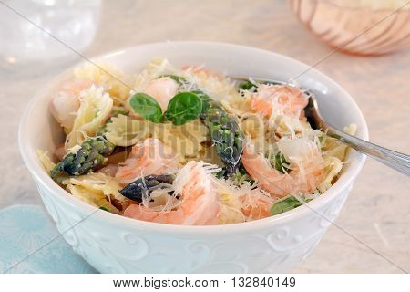 Gluten free bow tie pasta with prawns and asparagus in horizontal format