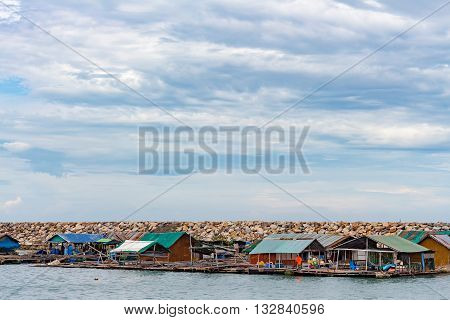 Fisher man live in houseboat in the sea.