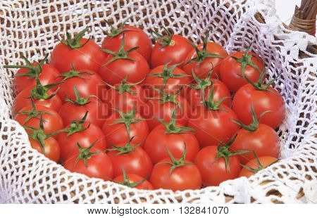 BASKET FULL OF CHERRY TOMATOES , CLOSEUP