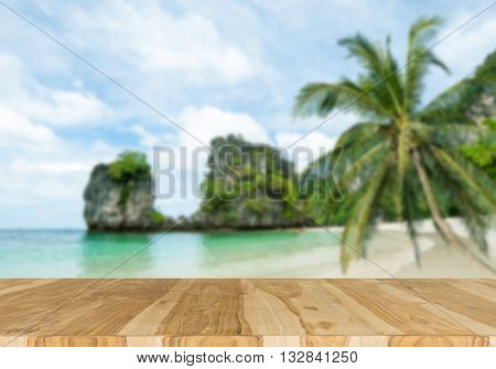 Wood table top on blurred beach background summer concept - can be used for display or montage your products