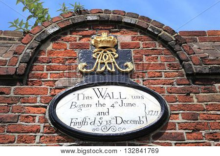 PORTSMOUTH, UK - JUNE 12, 2014: Historical wall at Portsmouth pier on June 12, 2014 in Portsmouth, UK. Portsmouth is a famous historic harbour with warship dockyard in the UK.