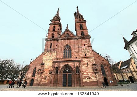 BASEL, SWITZERLAND- Nov 17, 2015: Basel cathedral on Nov 17, 2015 in Basel, Switzerland. It is a landmark historic cathedral in the city of Basel.