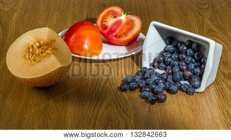 Group of different fruit and vegetables melon, blueberry, tomato