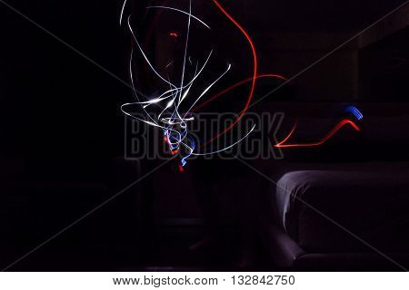 Light writing light streaks in dark room