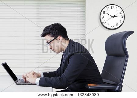 Portrait of middle eastern businessman typing on the laptop and looks concentration shot in the office