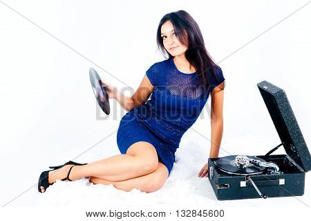 Beautiful woman with gramophone at white background