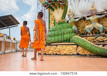 KRABI THAILAND - APRIL 10: Novice monks are observing hilltop of the Tiger Cave Mountain Temple on April 10 2016 in Krabi Thailand.