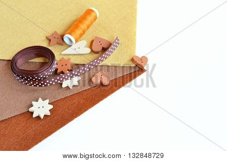 Set of sewing items - decorative ribbon, wooden buttons, thread, felt pieces. Materials for needlework