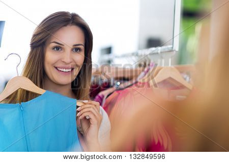Woman shopping in a clothing boutique