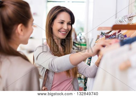 Two women shopping in a boutique