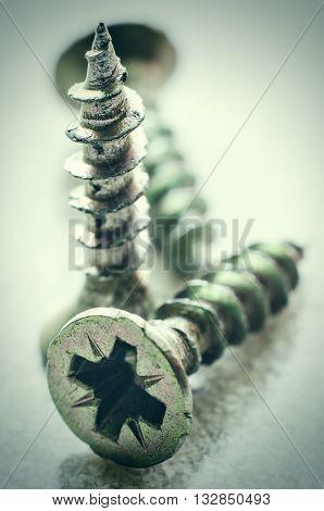 a three metal screws macro close up