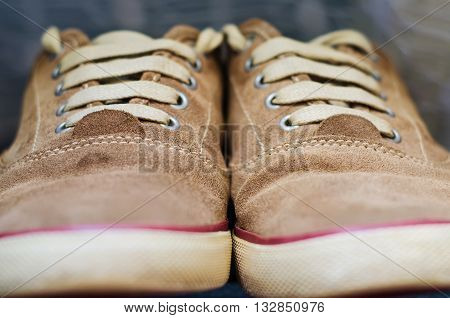 a pair of brown sneakers close up