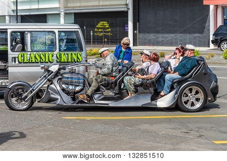 Napier New Zealand - November 19 2014: People on a Five seater Trikey motorcycle seen in Napier New Zealand.