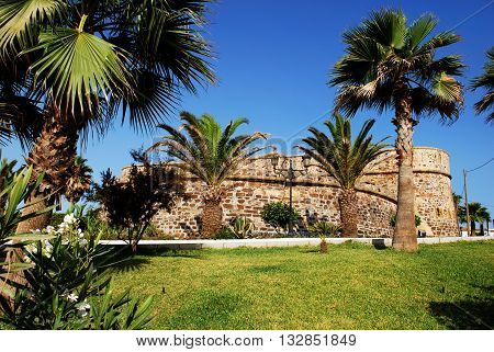 View of the castle with palm trees in the foreground Duquesa Malaga Province Andalucia Spain Western Europe.