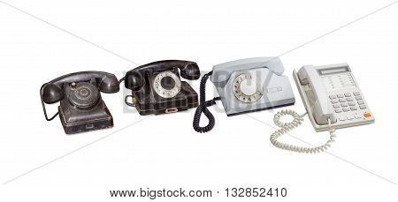 Old telephone set without dial two rotary dial telephone in bakelite and plastic housing and modern landline telephone with push button dial on a light background