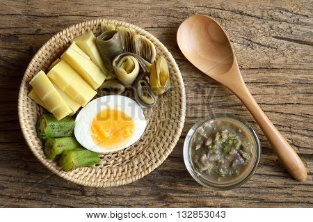 various boiled vegetables with nam prik or chili paste mixes. Thailand cuisine It's call