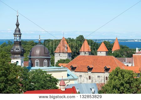 TALLINN, ESTONIA - AUGUST 01, 2015: View of the roofs of the houses in the old Tallinn, august day. Historical landmark of the Estonia