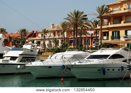 PUERTO SOTOGRANDE, SPAIN - JULY 18, 2008 - Yachts and boats in the marina with buildings to the rear Puerto Sotogrande Cadiz Province Andalucia Spain Western Europe, July 18, 2008.